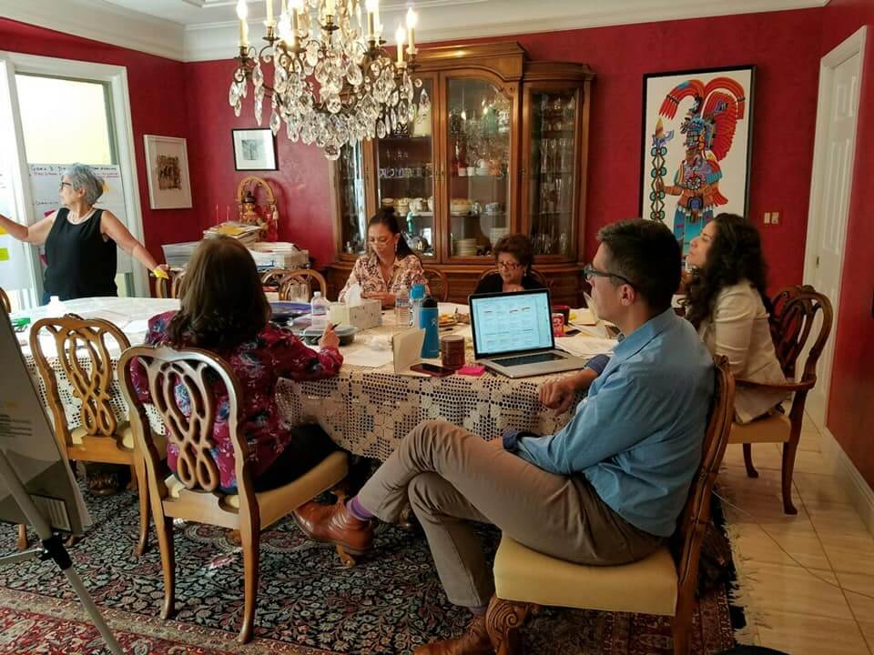 Caption: Castellano Family Foundation Board Meeting. Facilitator Teresa Faye-Bustillos, CFF Trustees Maria West, Carmen Castellano, Carmela Castellano-Garcia, and Armando Castellano, and Angie Briones CFF Program Director